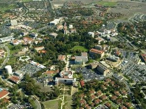 """Campus of the University of California, Irvine (aerial view, circa 2006)"" by Poppashoppa22 at en.wikipedia. Licensed under CC BY-SA 3.0 via Wikimedia Commons"