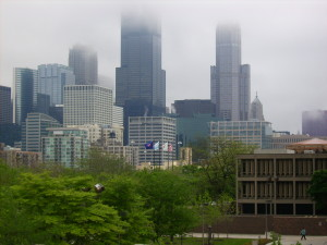 """Chicago downtown in fog from uic campus"" by Hied5 - Own work. Licensed under CC BY 2.5 via Wikimedia Commons."
