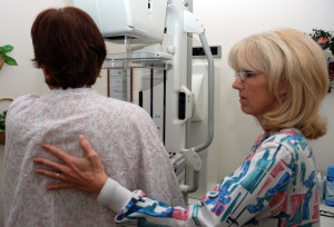 080922-N-2688M-004 SAN DIEGO (Sept. 22, 2008) Lead Mammography Technologist Carmen Waters, Naval Medical Center San Diego (NMCSD) Breast Health Center, assists a patient preparing for a mammography. In conjunction with NMCSDs pharmacy, the Breast Health Center has started a new program called ÒMammograms While You WaitÓ which allows patients to take the exam while their prescriptions are being filled. (U.S. Navy photo by Mass Communication Specialist 2nd Class Joseph Moon/Released)